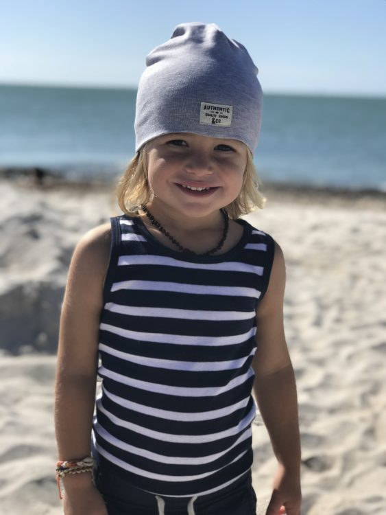 the author's child smiling on the beach