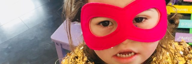 Girl with Down syndrome wearing a mask