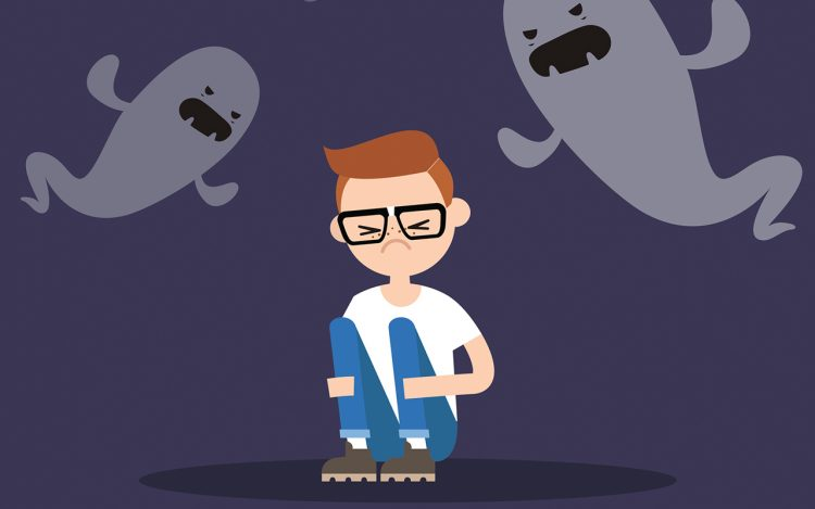 A man being haunted by ghosts