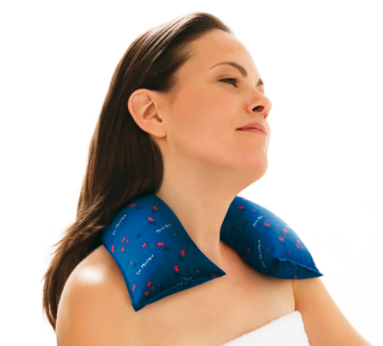 woman with heating bag around neck