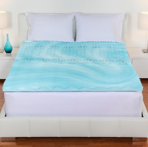 blue foam mattress topper on bed