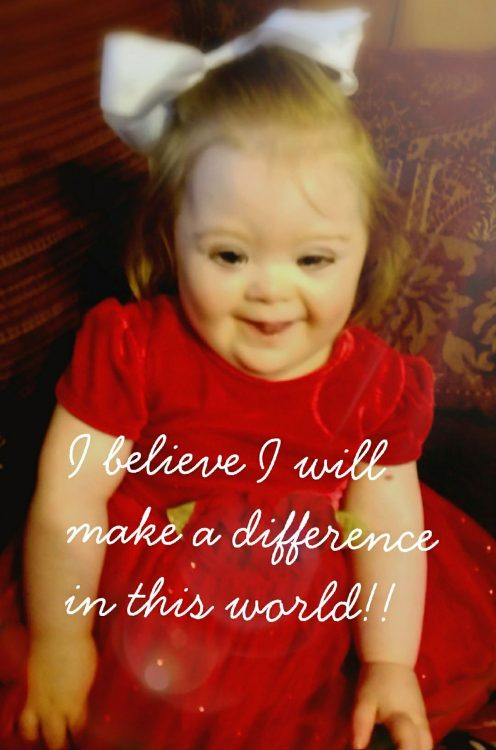 "Little girl with Down syndrome wearing red dress. Over the photo the words: ""I believe I will make a difference in this world"""