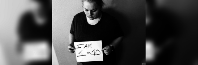 black and white photo of a woman holding a sheet of paper that says 'I am 1 in 10'