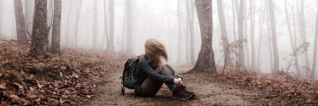 woman sitting on trail