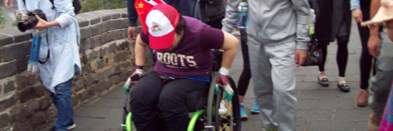 Kuen rolling along the Great Wall of China.