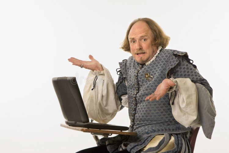 shakespeare sitting at a desk with a computer and shrugging in confusion at technology