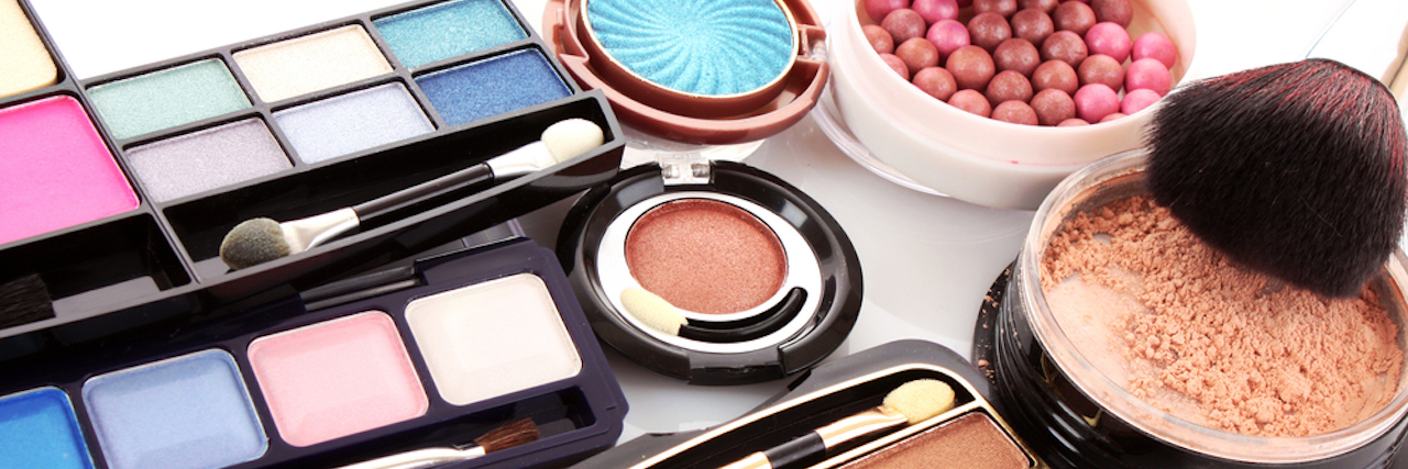 closeup photo of colorful eyeshadow, blush and other makeup products