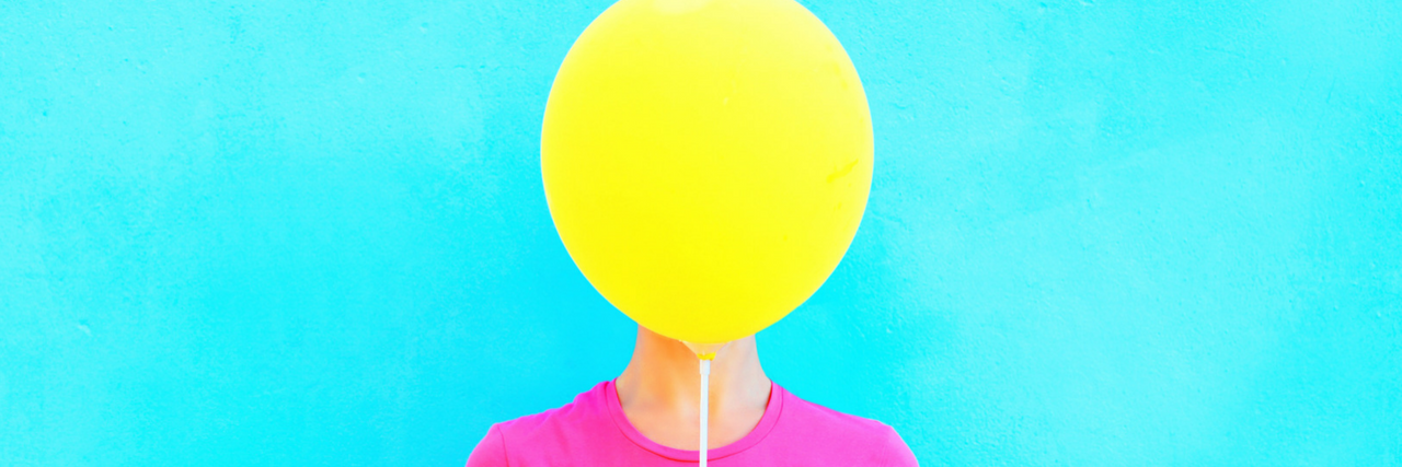 woman with balloon in front of her face
