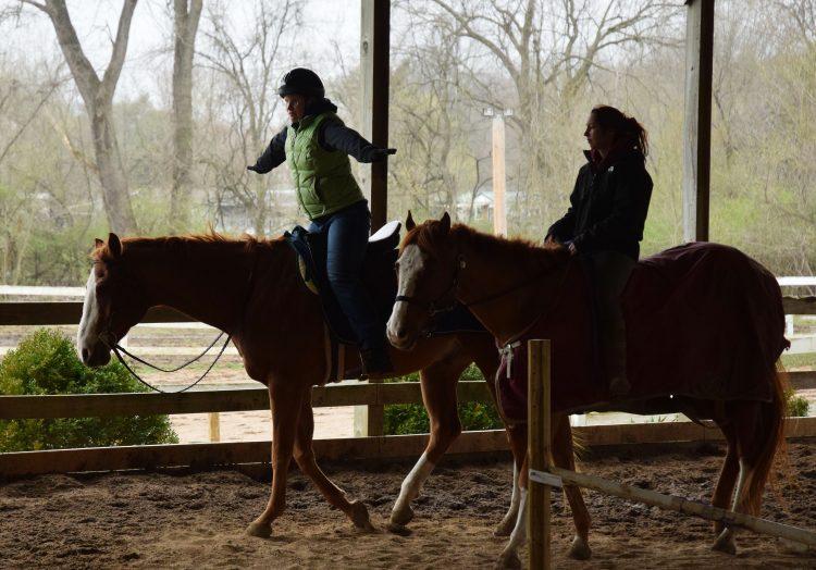 Sally and a friend each riding a horse