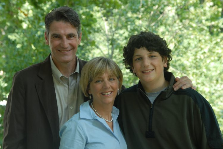 Image of author with her son and husband
