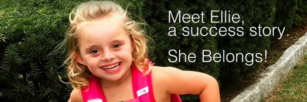 """Youtube video screen shior of Ellie, who has Down syndrome, and the caption """"Meet Ellie, a success story. She belongs."""""""