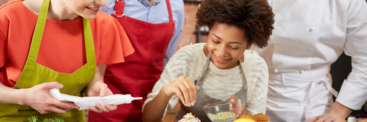 Young people learning to bake.