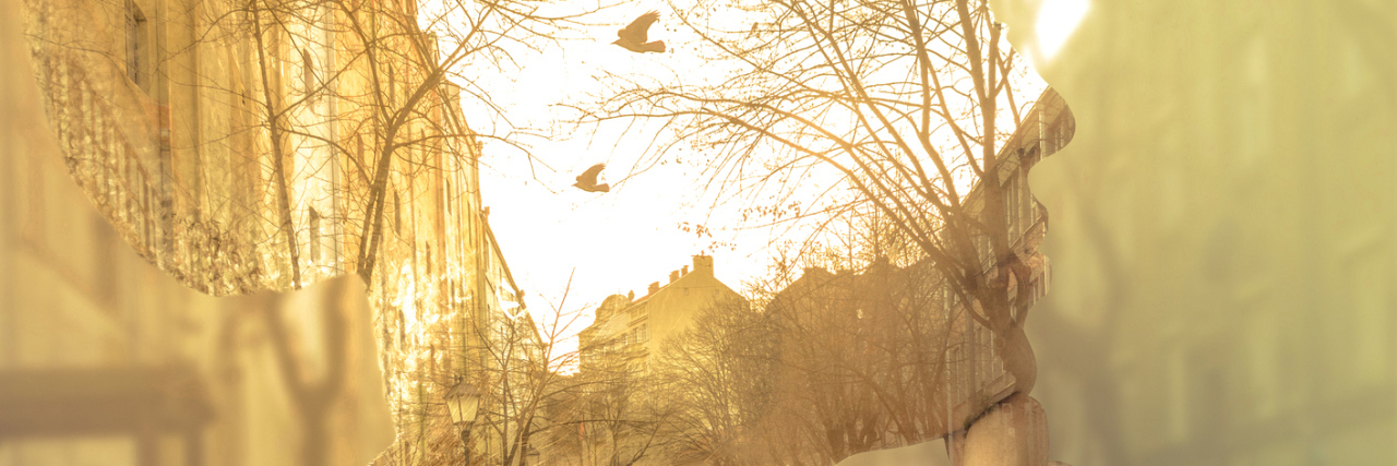 double exposure of a woman thinking and a street with birds flying around at sunset