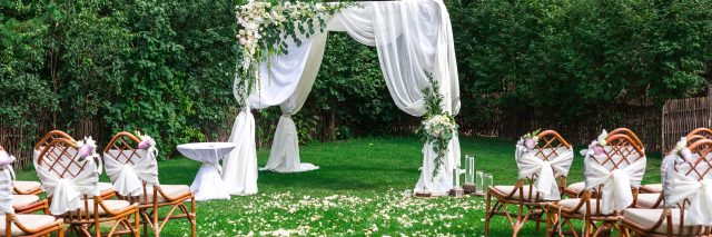 Outdoor wedding ceremony waiting for bride and groom and guests.