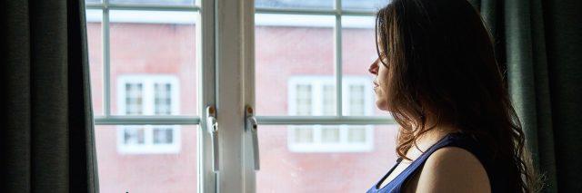 Maternity Portrait in front of window in UK.