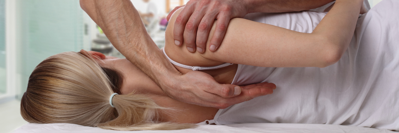 Woman with physical therapist.