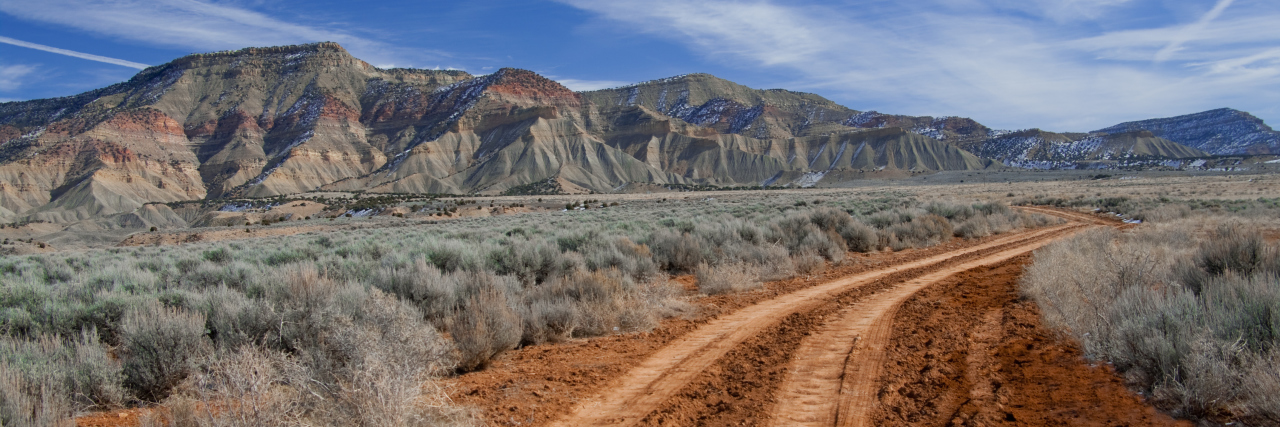 A rough dirt road leads into the North Fruita Desert in western Colorado.