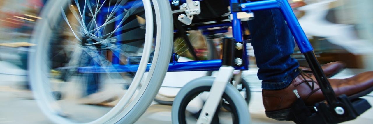 Motion in wheelchair.