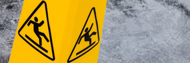 Caution wet floor, yellow warning sign.