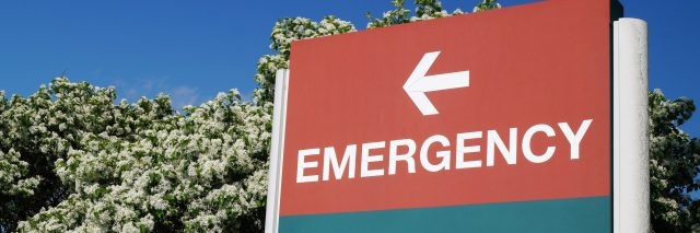 emergency sign pointing to the left