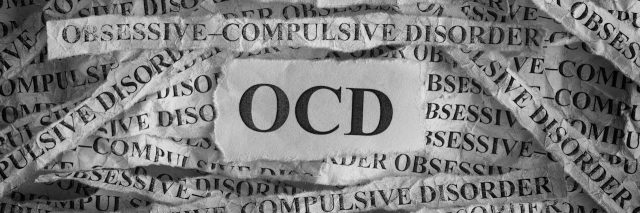 ripped papers that say OCD