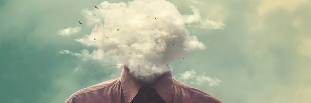 stressed man head in the cloud