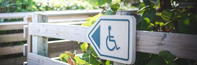 Wheelchair sign on path.
