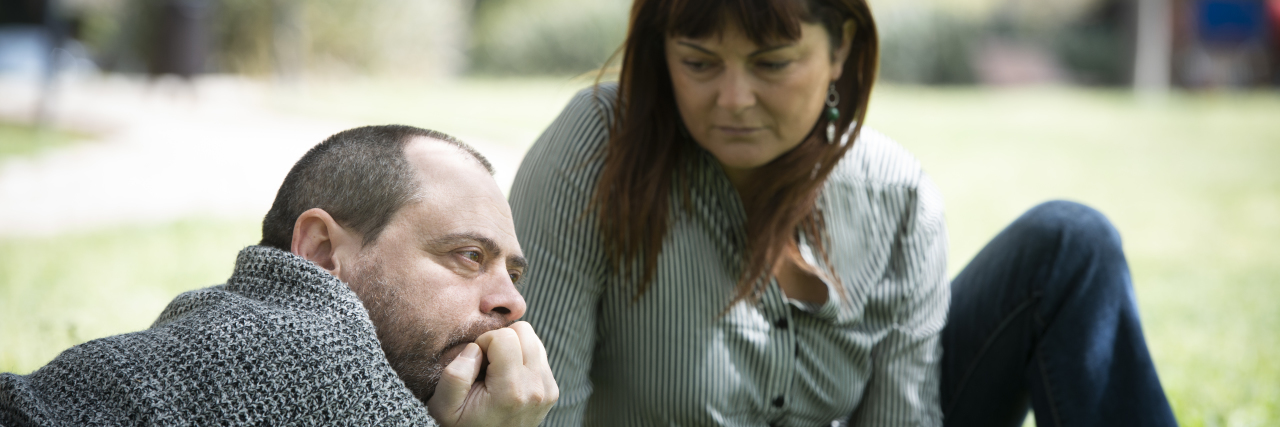 Woman supporting stressed out man.
