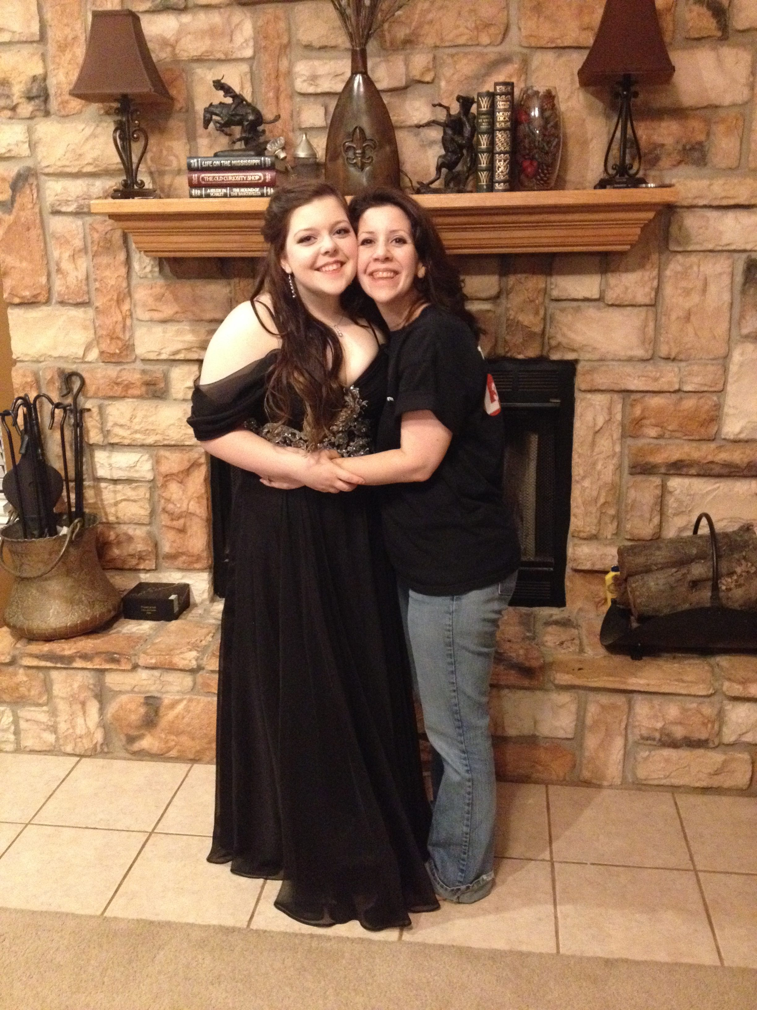 A picture of the writer with her daughter, who is wearing a beautiful, long, black dress.