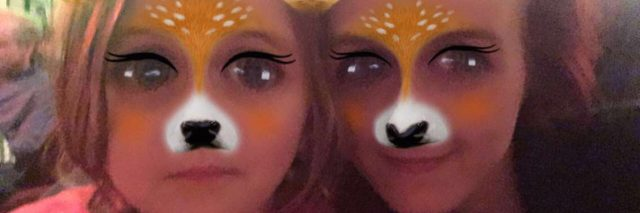 A photo of the writer and her daughter, while wearing the Snapchat deer filter.