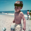 A picture of the writer on the beach as a child.