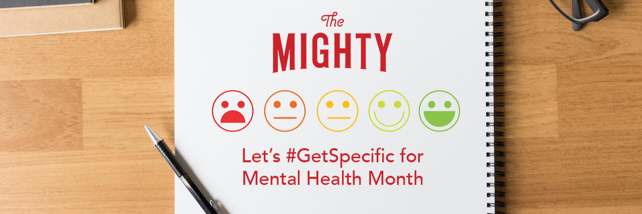 A notepad with The Mighty logo on it. Text reads: Let's #GetSpecific for Mental Health Month