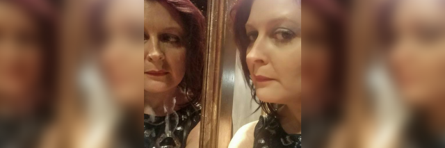 the author taking a photo with her face reflected in a mirror
