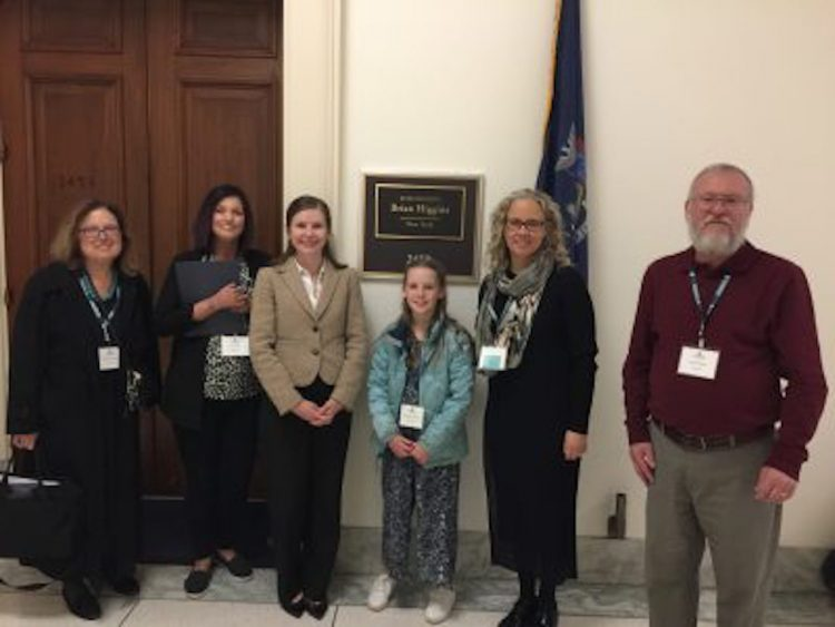 Aimee and other advocates standing in front of a representatives office