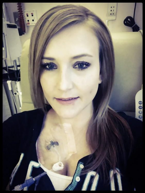 Brenda smiling in the hospital with a port