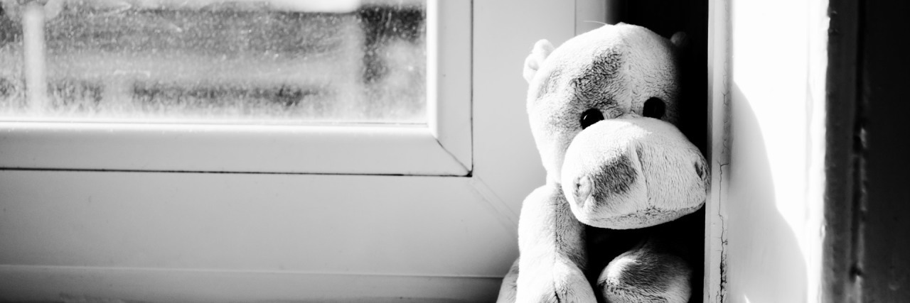hippo toy on window sill black and white