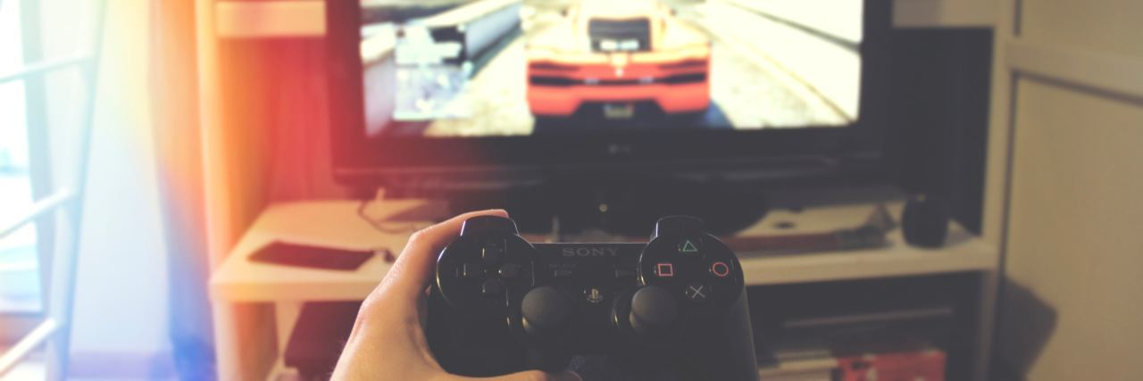 view of playstation controller in front of TV