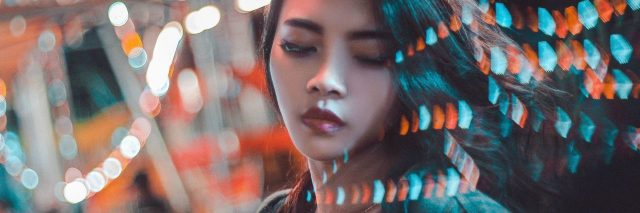 asian woman with lights going through her face