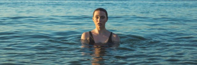 woman in the middle of an ocean