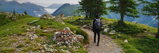 woman walking along mountain path