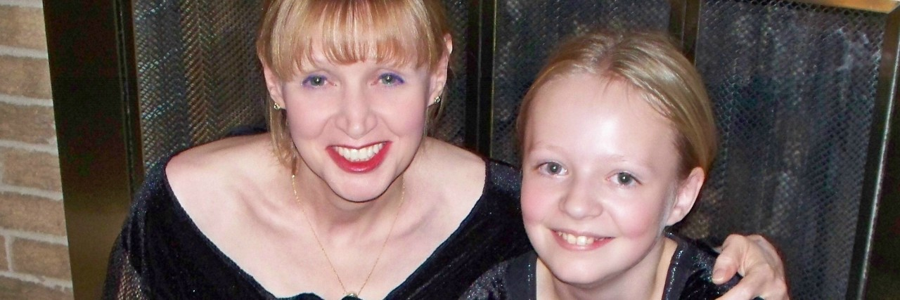 mom and daughter wearing matching black dresses