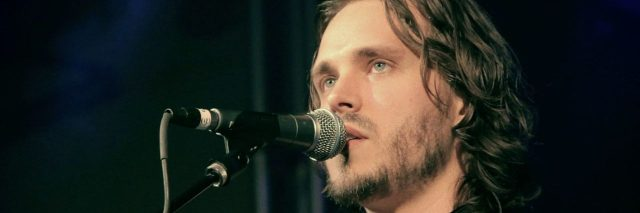 A picture of the lead singer from Enation.