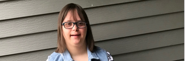 Young woman with Down syndrome posing for camera