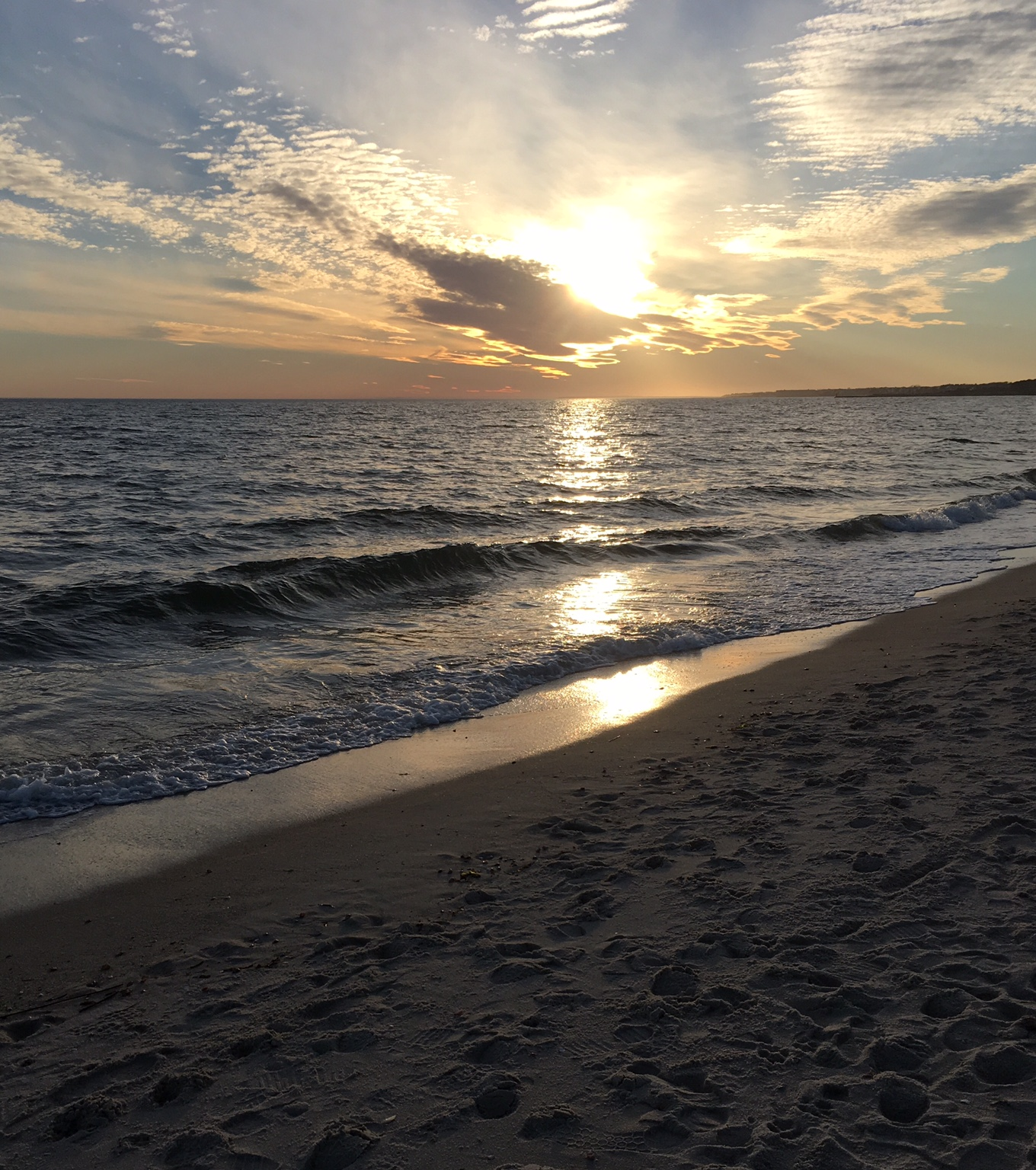 A picture of the beach at Cape Cod, during the sunset.