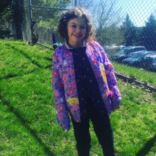 the author's daughter in a coat outside