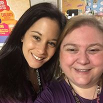 two women wearing purple shirts