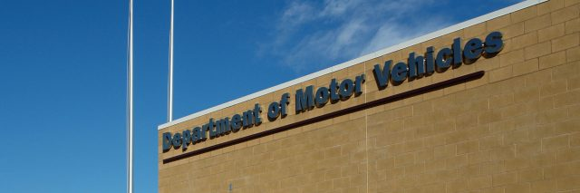 A Department of Motor Vehicles DMV brick building.