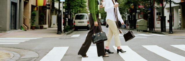 Two women crossing city street.