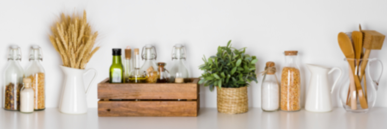 Cooking utensils and herbs in kitchen.