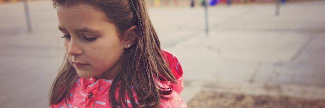Sad girl in the school playground